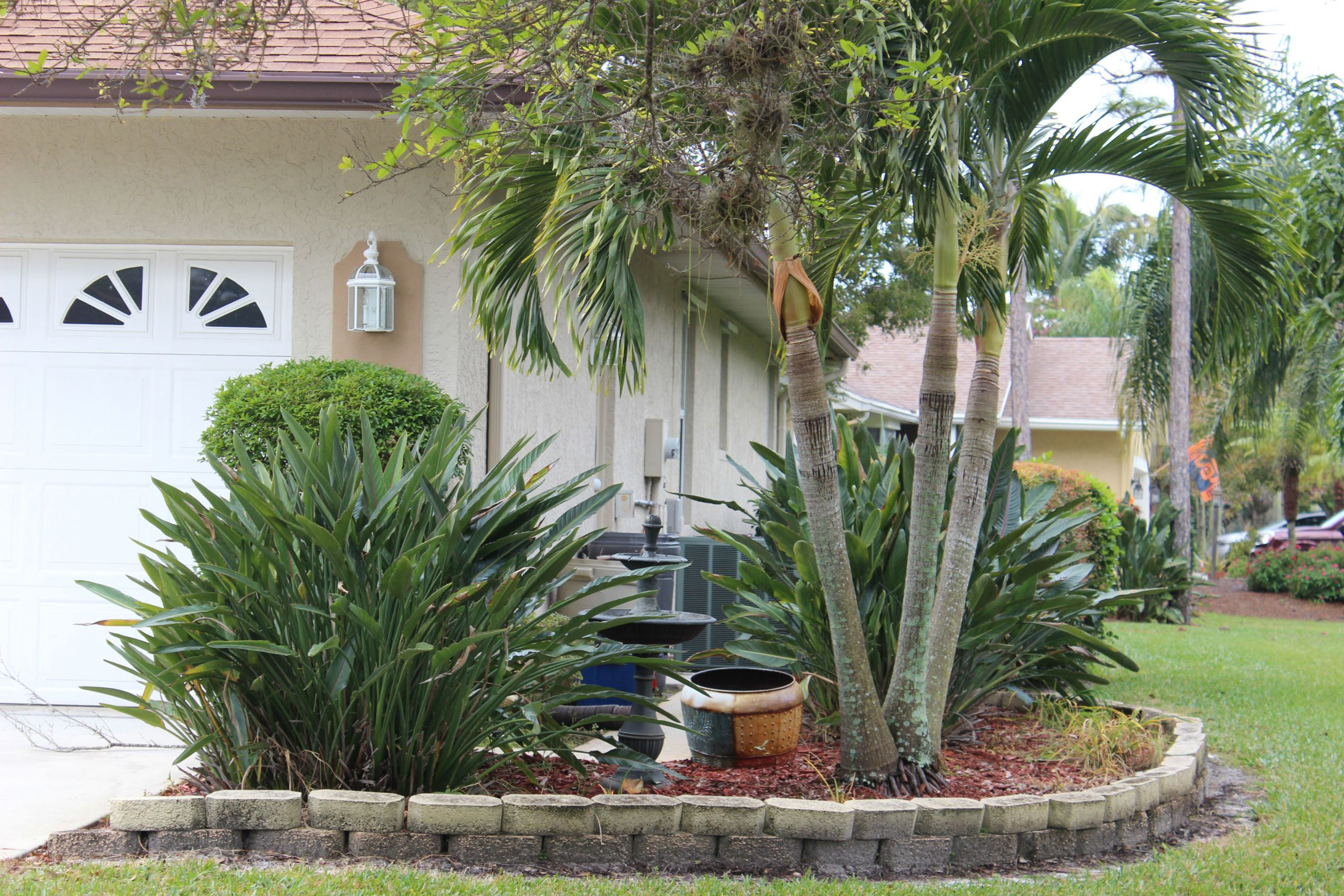 Artificial Outdoor Landscaping  Concealing Air Conditioners with Artificial Outdoor Plants