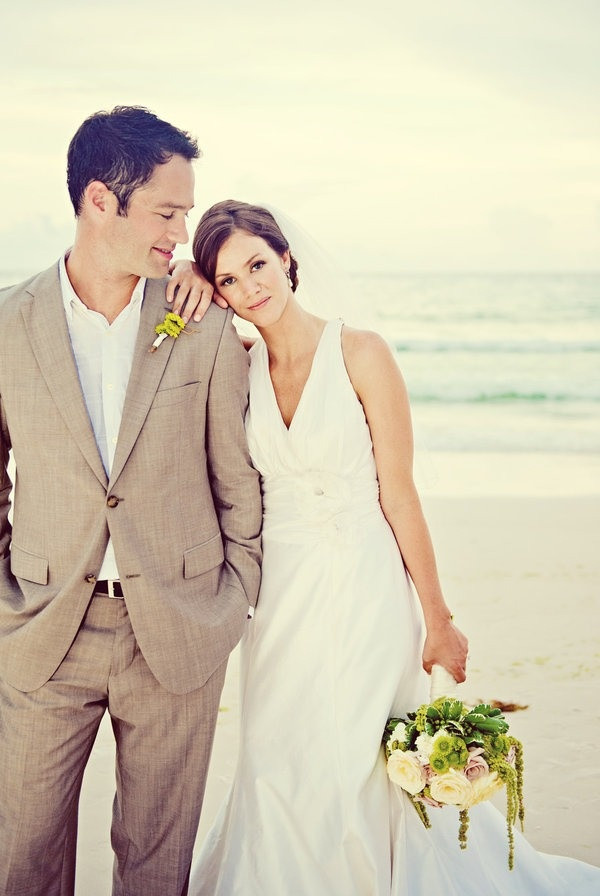 Beach Wedding Attire For Groom  Picture a tan suit and a white shirt – you won't need