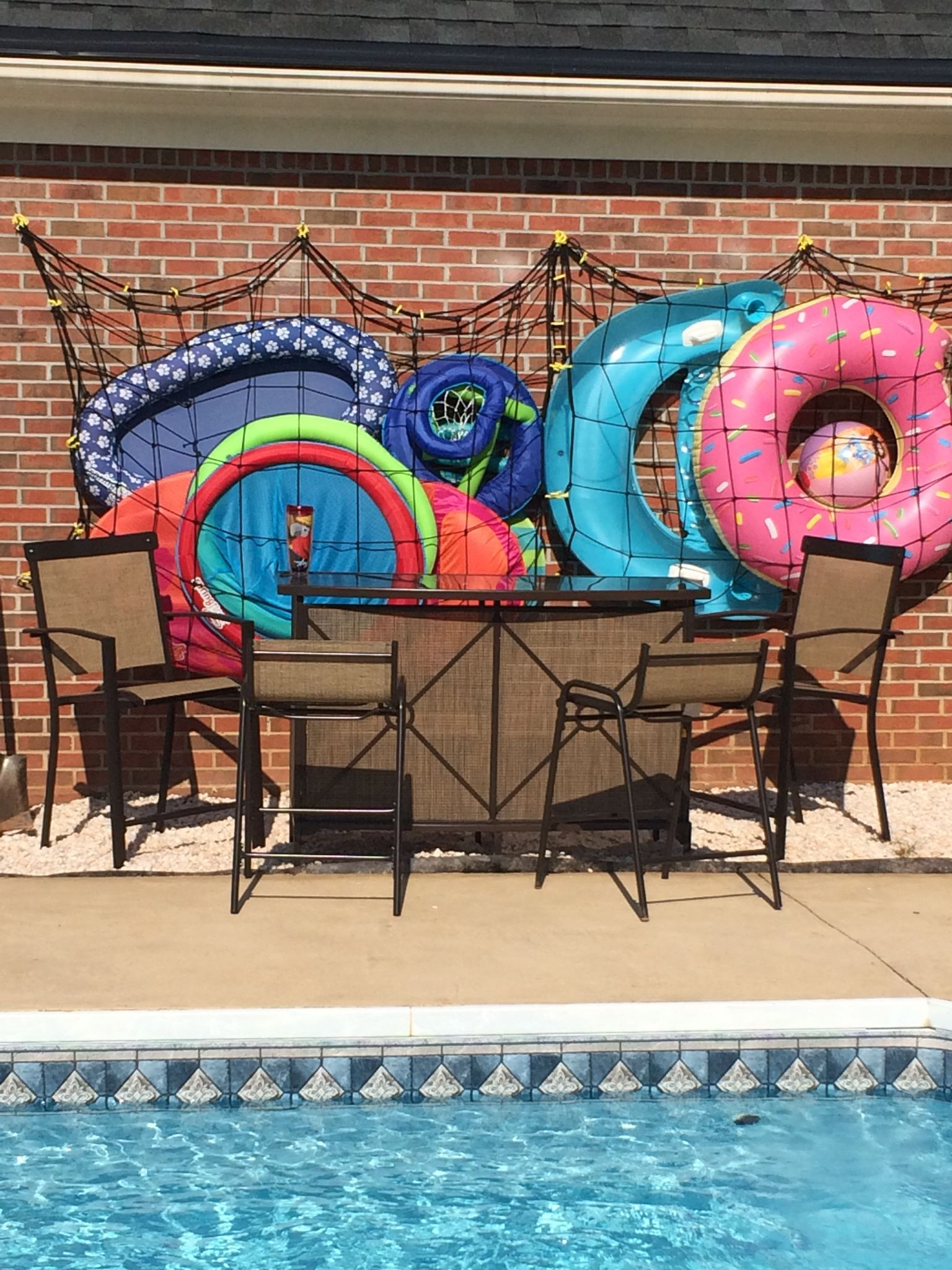 DIY Pool Float Organizer  Our solution for a backyard bar cargo net swimming pool