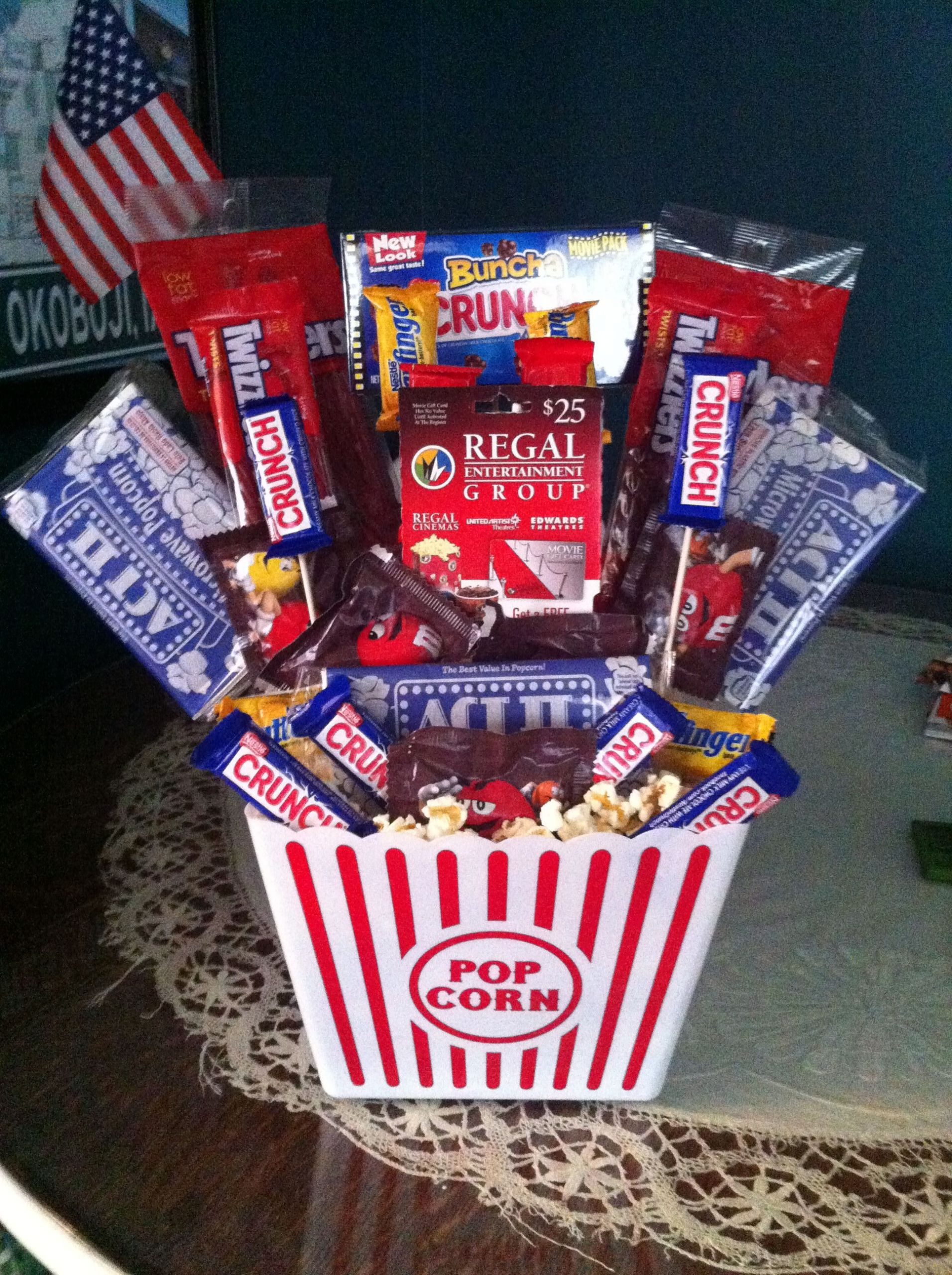 Movie Gift Basket Ideas  Movie themed basket With a regal t card in middle