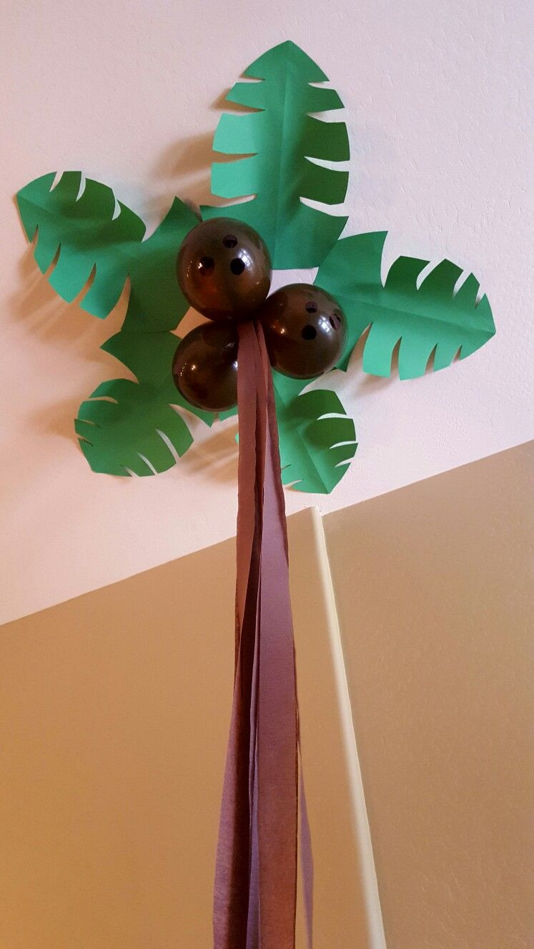 Palm Tree Decorations DIY  I ordered the biggest available green construction paper
