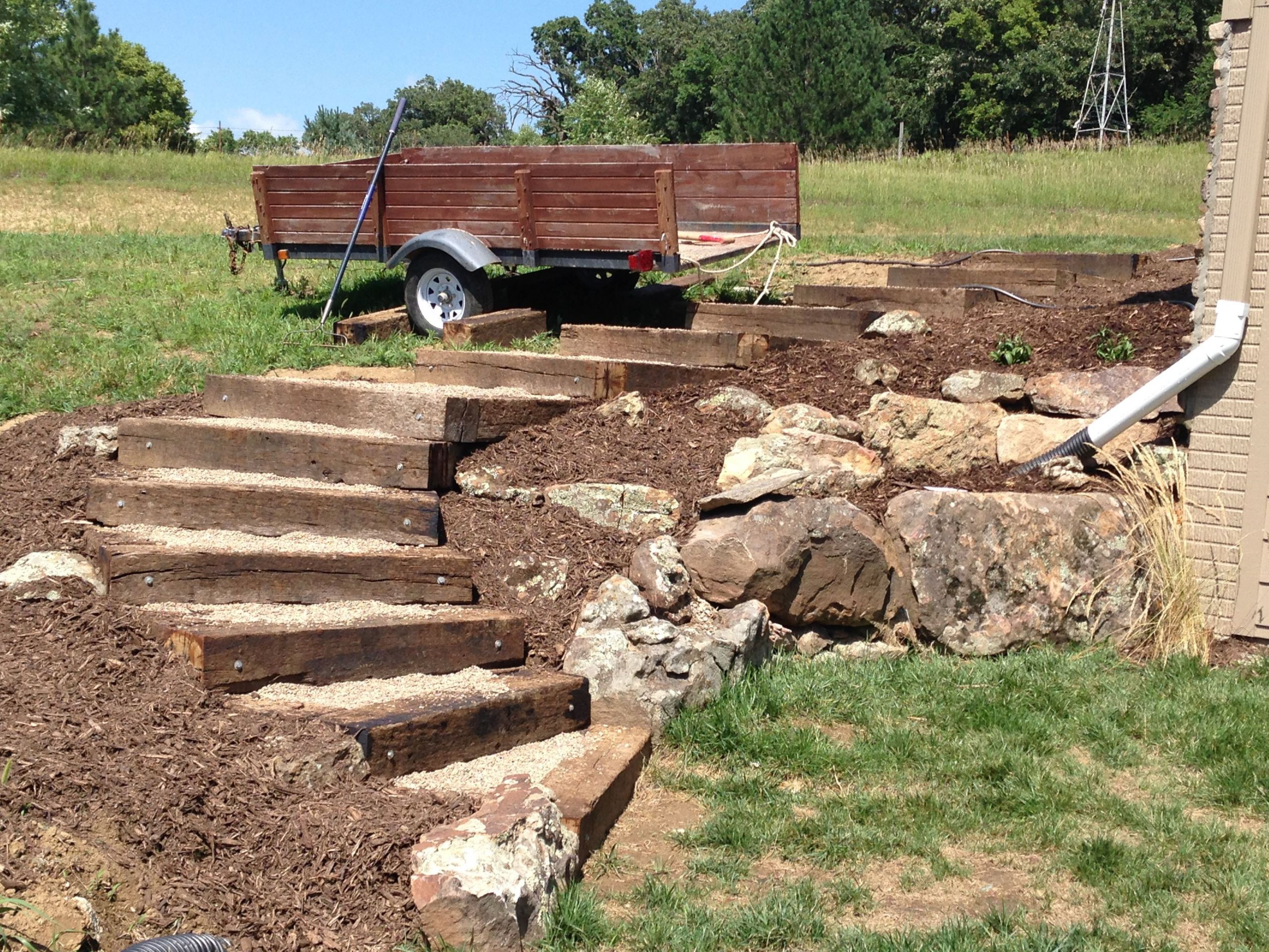 Terrace Landscape With Railroad Ties  Railroad tie timber steps filled with pea gravel Outdoor