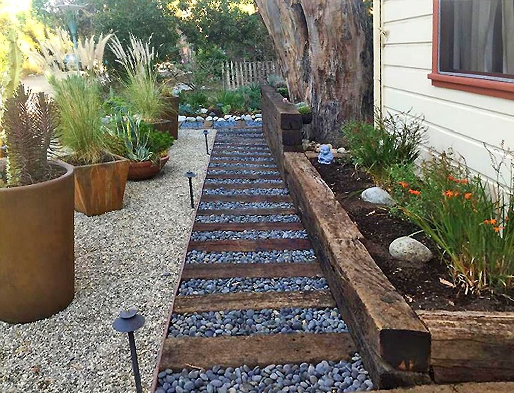 Terrace Landscape With Railroad Ties  A creative use of railroad ties river rocks and gravel